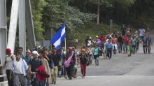 Trump warns of aid cut over migrant caravan now in Guatemala