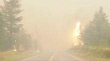 Video shows frightening drive through B.C. wildfire