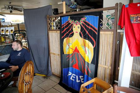 FILE PHOTO: A depiction of the Hawaiian goddess Pele is seen hanging on the wall of a local restaurant in Pahoa, Hawaii, U.S., May 25, 2018. REUTERS/Marco Garcia/File Photo