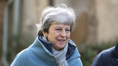May gathers team as MPs seek to take control of Brexit