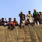 India's govt. invites protesting farmers to talks Tuesday