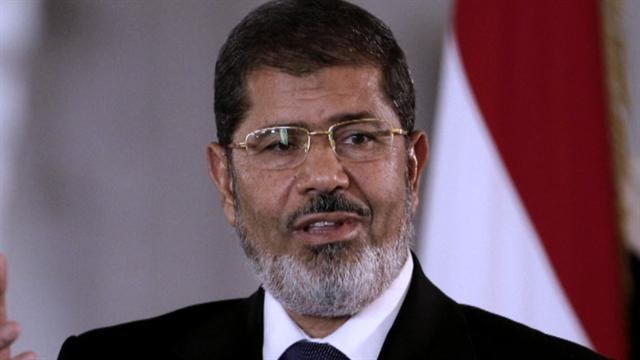 Egypt's Morsi returns after fleeing protesters