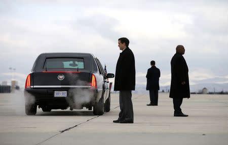 Secret Service agents keep watch on the tarmac as U.S. President Barack Obama arrives in Boise