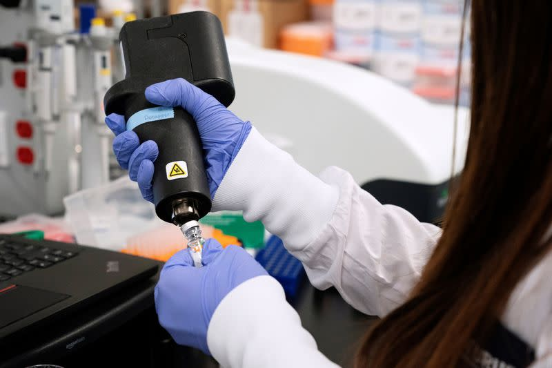 FILE PHOTO: A scientist at RNA medicines company Arcturus Therapeutics research a vaccine for the novel coronavirus (COVID-19) at a laboratory in San Diego