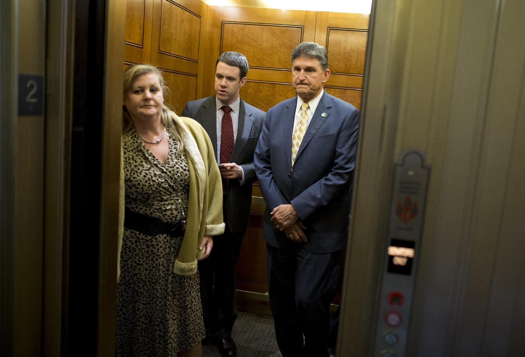 Sen. Joe Manchin, D-W.Va., right, co-author of gun control legislation, gets in an elevator after a caucus on Capitol Hill in Washington, Thursday, April 18, 2013. (AP Photo/Evan Vucci)