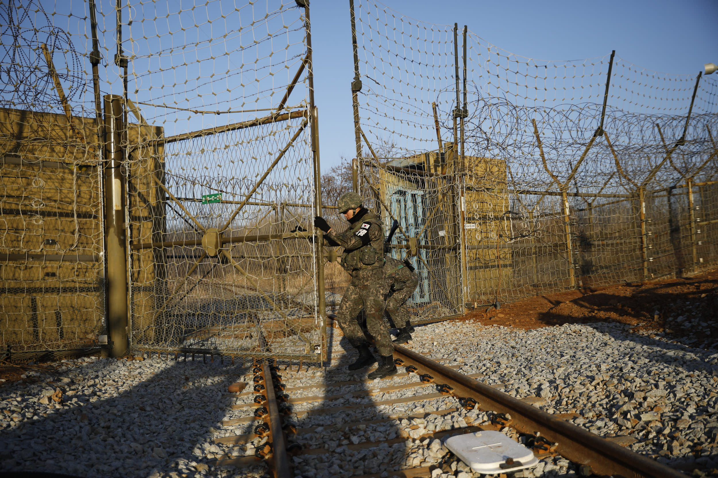 PAJU, SOUTH KOREA - NOVEMBER 30:  South Korean soldiers stand guard next to the rails which leads to North Korea, inside the demilitarized zone separating the two Koreas on November 30, 2018 in Paju, South Korea.  (Photo by Kim Hong-Ji-Pool/Getty Images)