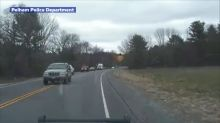 Driver nearly swerves into head-on collision with police cruiser, video shows
