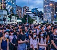 Hong Kong protesters block road outside Carrie Lam's office to demand she step down