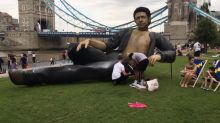 A 25ft half-naked Jeff Goldblum appeared in front of London's Tower Bridge and promptly got damaged