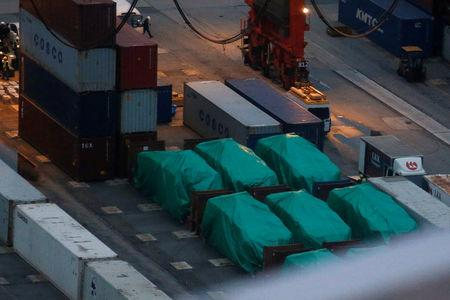 Six of the nine armoured troop carriers belonging to Singapore, from a shipment detained at a container terminal, are seen in Hong Kong