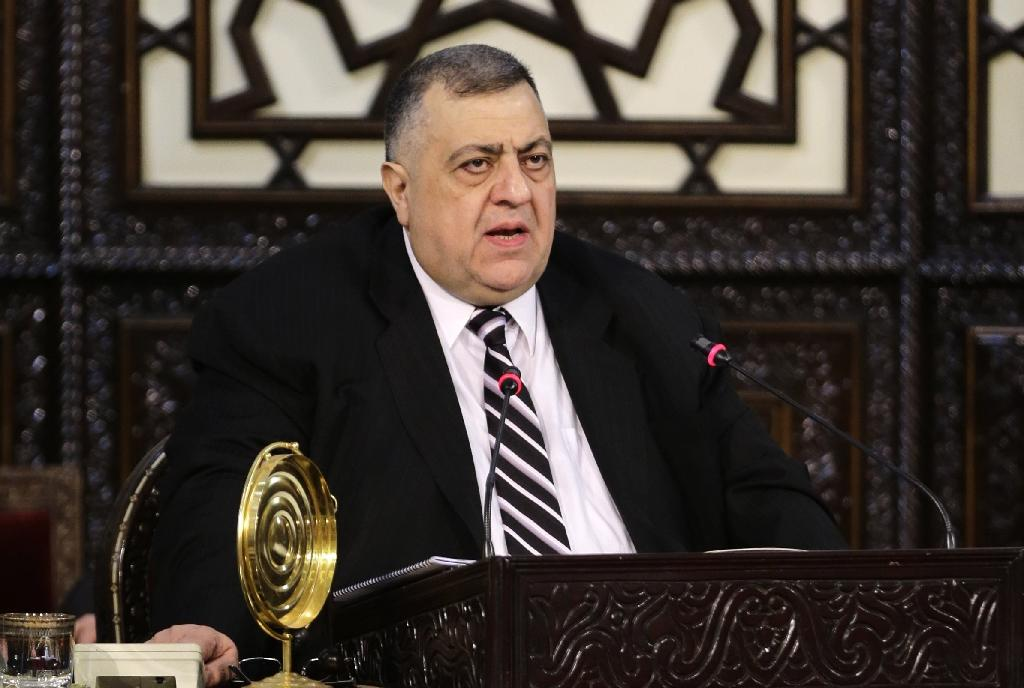 Newly elected Syrian parliament speaker Hammudeh Sabbagh, the first Christian to hold the post in decades, delivers a speech
