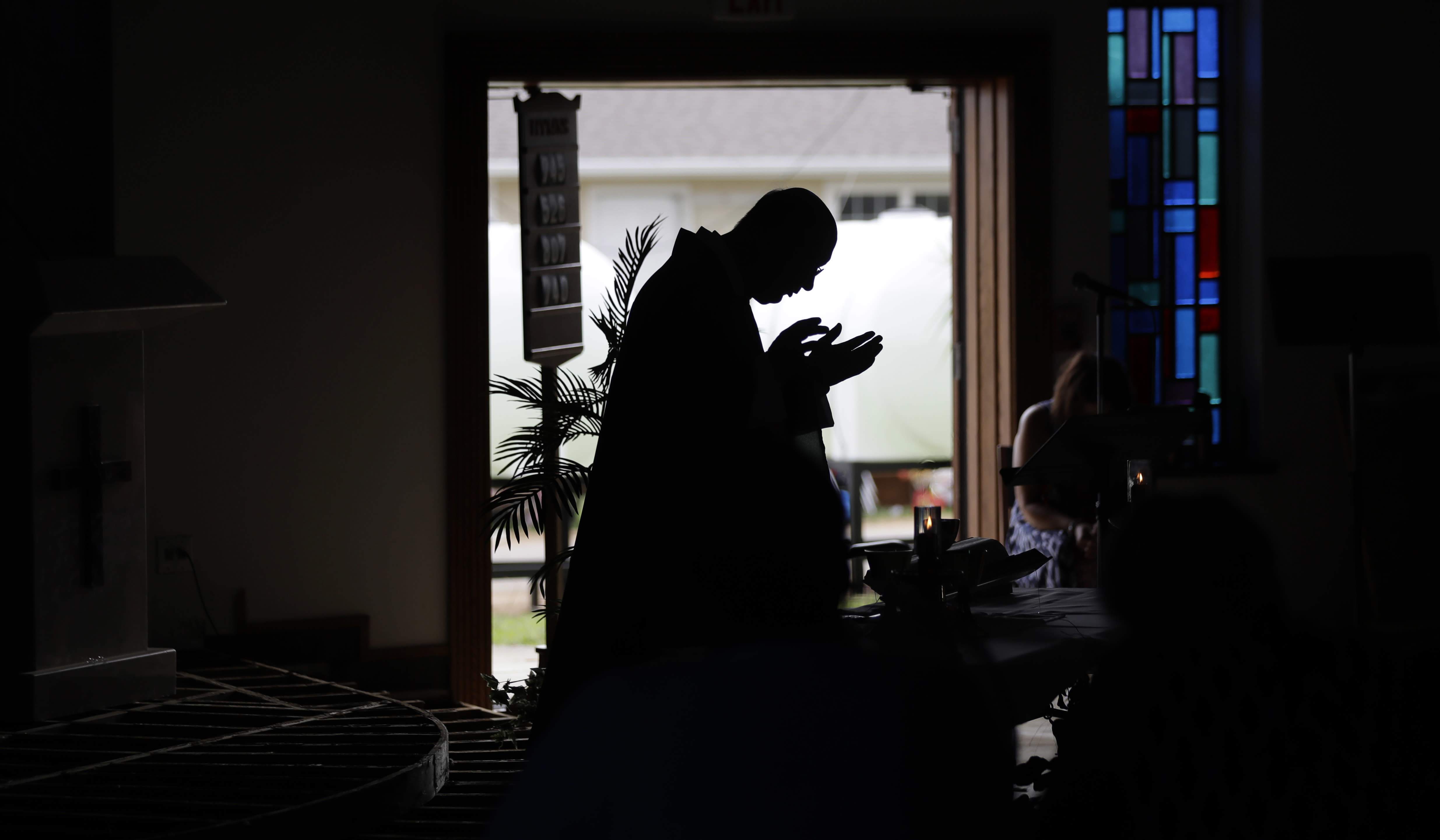 <p>Father Kris Bauta celebrates Mass at St. Joseph Catholic Church which was damaged from the effects of Hurricane Harvey, Sunday, Sept. 3, 2017, in Port Aransas, Texas. The church and Port Aransas is still with out electricity. (Photo: Eric Gay/AP) </p>