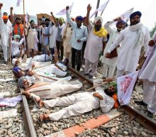 Indian farmers intensify protests over new grain bills