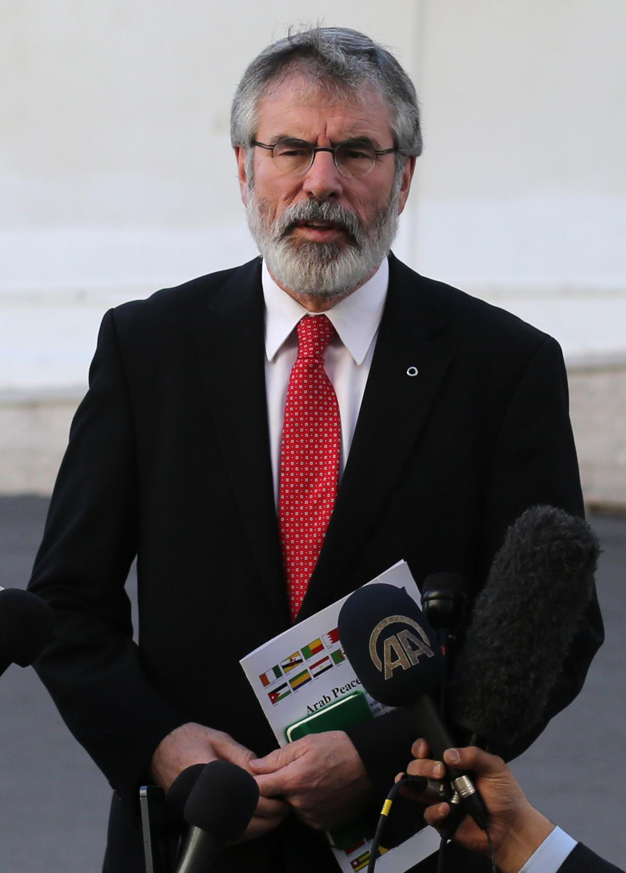 Irish republican politician and president of the Sinn Féin political party Gerry Adams talks to the press on December 4, 2014 during his visit to the West Bank city of Ramallah (AFP Photo/Abbas Momani)