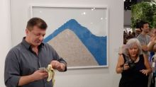 Man Eats $120,000 Banana Taped to Wall at Art Basel Miami