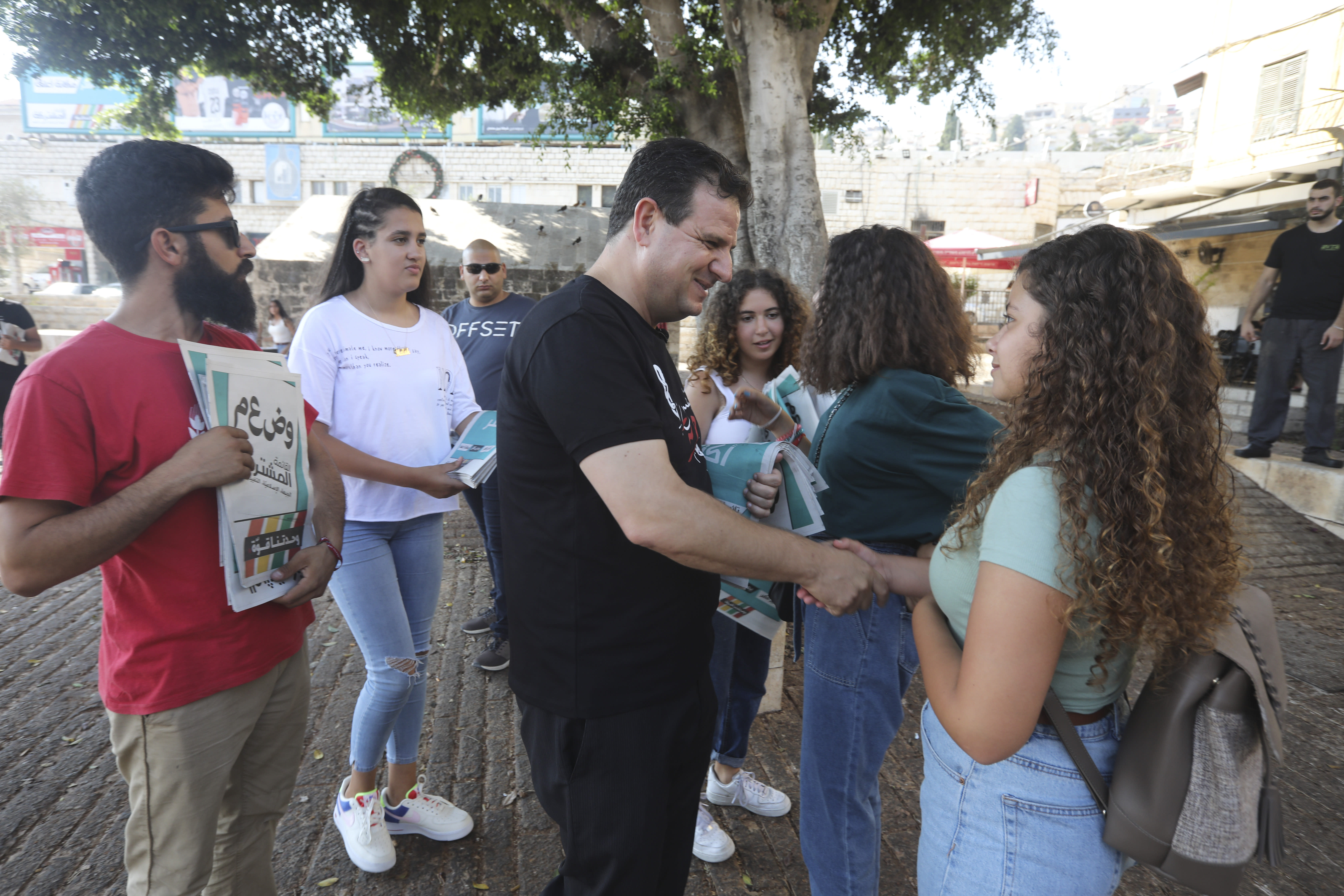 In this Thursday, Aug. 29, 2019 photo, Ayman Odeh, the leader of the Arab Joint List parties, meets constituents in Nazareth, Israel. Odeh has shaken up Israel's election campaign by offering to sit in a moderate coalition government _ a development that would upend decades of convention that has relegated Arab parties to the sidelines and could bring down Prime Minister Benjamin Netanyahu. (AP Photo/Mahmoud Illean)