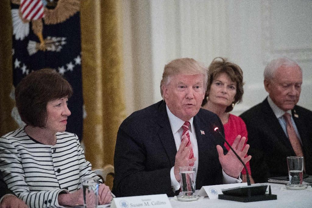 US President Donald Trump is flanked by US Senators Susan Collins (left) of Maine, Lisa Murkowski (second right) of Alaska and Orrin Hatch (right) of Utah (AFP Photo/NICHOLAS KAMM)