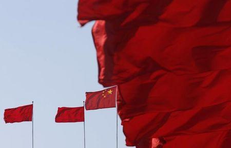 Flags flutter ahead of the opening session of Chinese People's Political Consultative Conference at Tiananmen Square in Beijing