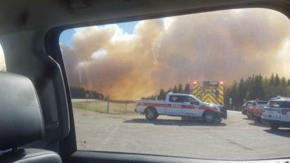 Wildfire jumps highway as homes evacuated in Alberta