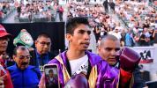 Vargas battles through cuts to retain WBC title