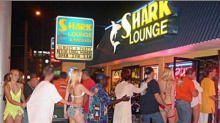 The twin pillars of Daytona: A racetrack and a bikini bar
