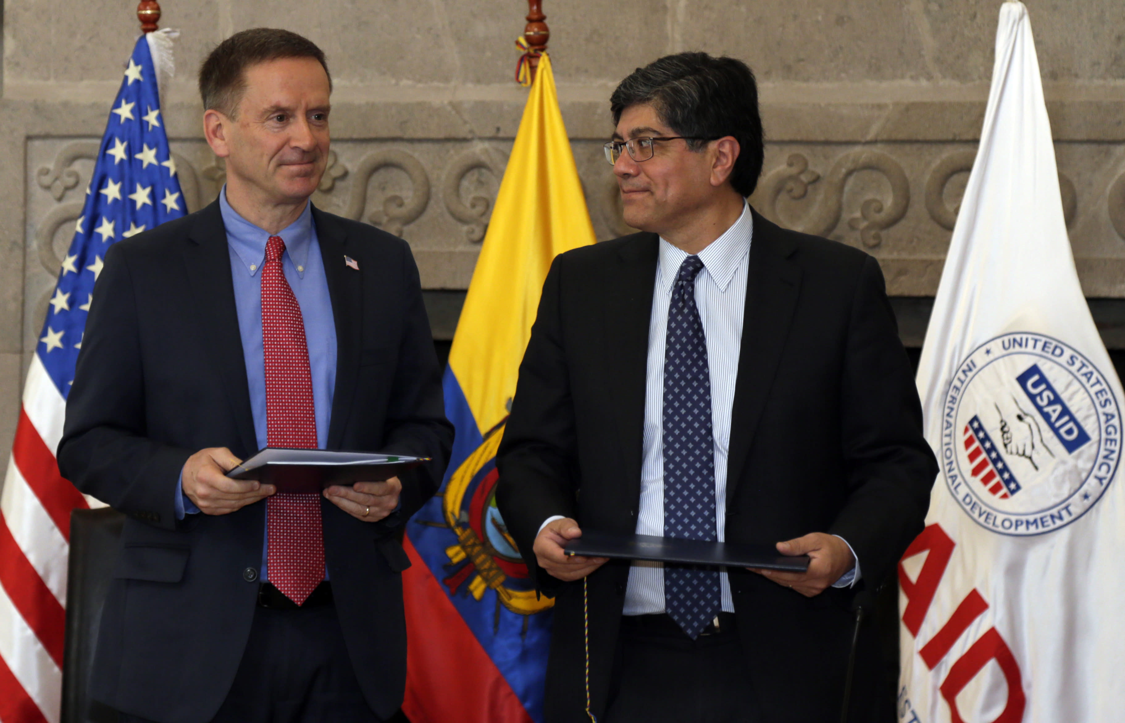 Mark Green, USAID Administrator, and Ecuador's Foreign Minister Jose Valencia, stand during a signing ceremony in Quito, Ecuador, Wednesday, May 15, 2019. USAID returns to Ecuador for the first time since being expelled from the country in 2014 by former President Rafael Correa. (AP Photo/Dolores Ochoa)