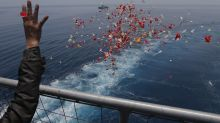 Relatives of Lion Air victims pray, cast flowers into sea