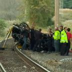Car crashes onto train tracks, bursts into flames in Rockland County