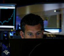 U.S. stocks drop on downbeat earnings, trade tensions