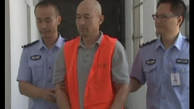 Police question cult members over east China murder