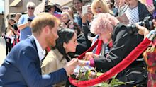 Prince Harry introduces pregnant Meghan Markle to his 98-year-old superfan during Australia tour