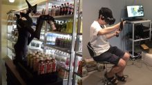 Remote-controlled robot stocks shelves at Japanese convenience store Family Mart