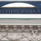 Latvia central bank chief held by anti-corruption agency, urged to step aside