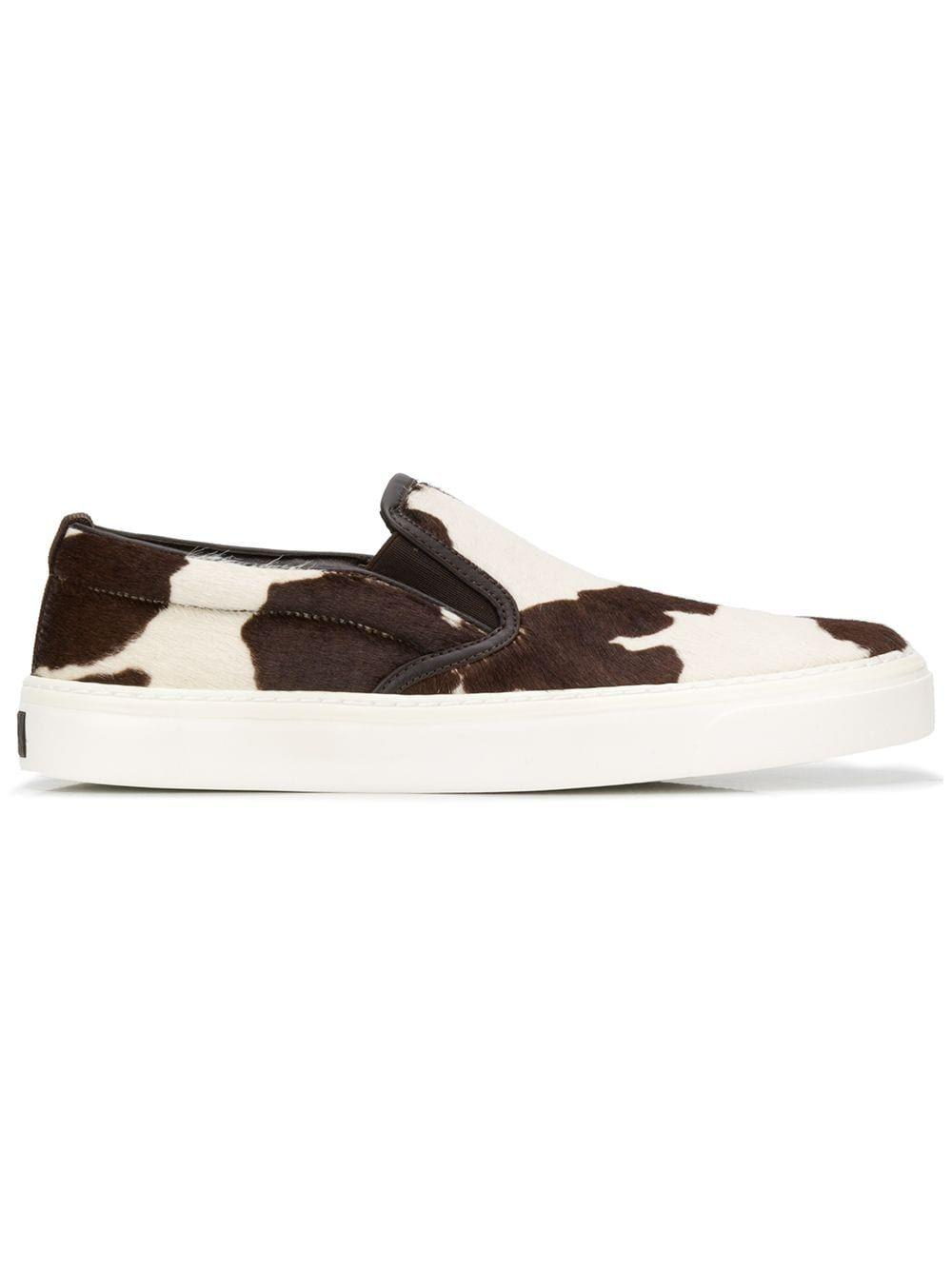 """<p><strong>Gucci</strong></p><p>farfetch.com</p><p><strong>$690.00</strong></p><p><a href=""""https://go.redirectingat.com?id=74968X1596630&url=https%3A%2F%2Fwww.farfetch.com%2Fshopping%2Fwomen%2Fgucci-cowhide-slip-on-sneakers-item-13611042.aspx&sref=https%3A%2F%2Fwww.marieclaire.com%2Ffashion%2Fg30859606%2Fslip-on-sneakers%2F"""" rel=""""nofollow noopener"""" target=""""_blank"""" data-ylk=""""slk:SHOP IT"""" class=""""link rapid-noclick-resp"""">SHOP IT</a></p><p>Tap into your animalistic side fashion wise by sporting these cow print slip-on sneakers. The elastic gives the shoe a little flexibility as you slide your feet into it while the white rubber sole makes this sneaker feel clean and streamlined. </p>"""