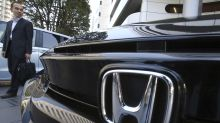 Honda reports fiscal quarterly loss, to streamline models