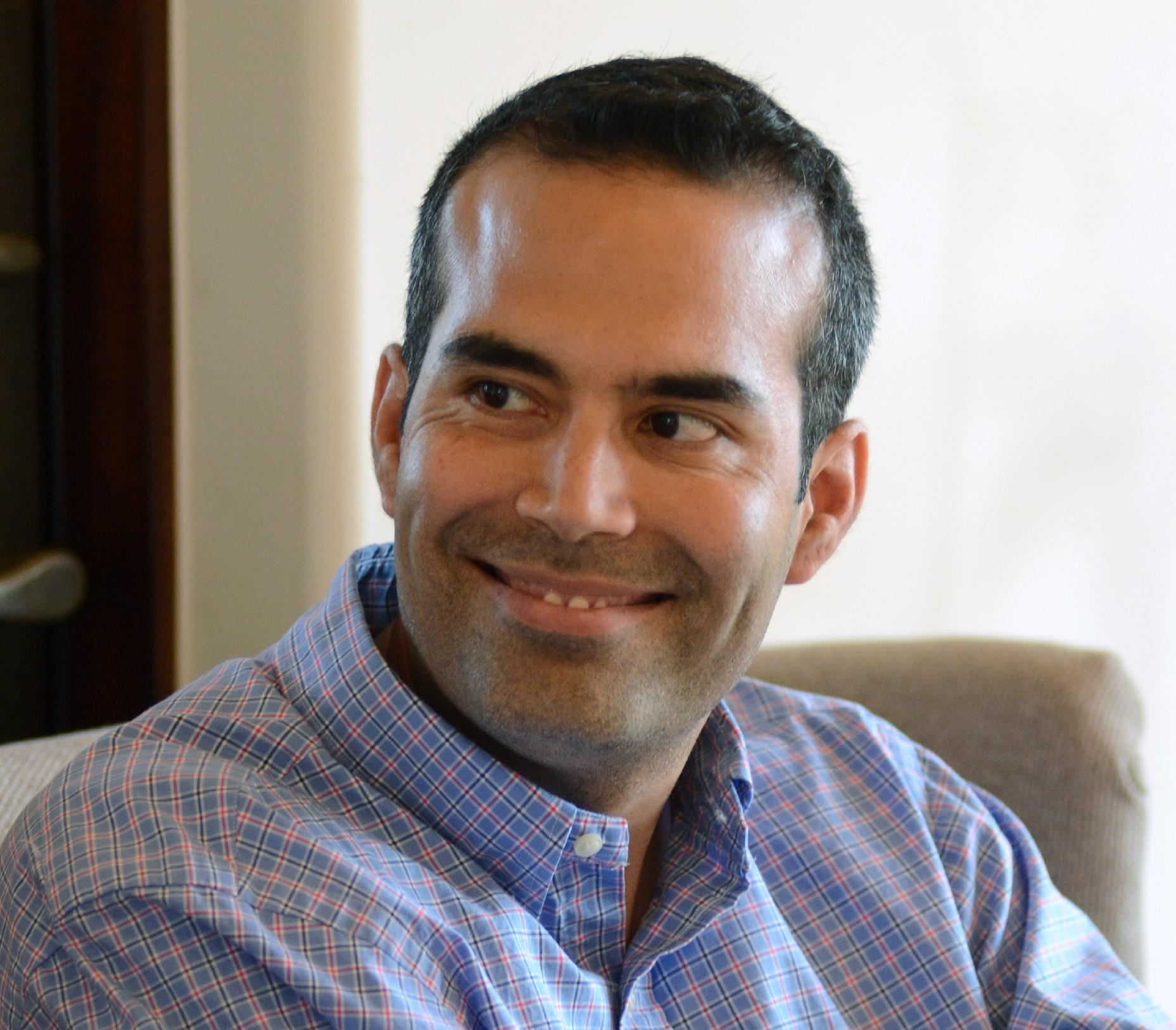 In this photo taken June 25, 2013, George P. Bush, 37, smiles during an interview with The Associated Press in Frisco, Texas. Bush is running for Texas Land Commissioner, a post unfamiliar to most Texans, because he says it best suits his skills, not because it could launch him to bigger things in America's largest red state. Born in Houston, Bush grew up in Florida, graduated from and played baseball for Rice University in Houston before teaching school in inner-city Miami and working on George W. Bush's presidential campaign. He earned a law degree from the University of Texas and clerked for a federal judge, then founded a capital company in Fort Worth. He served an eight-month tour in Afghanistan in 2010 with U.S. Naval Intelligence. Bush is on the board of Uplift Education, a major charter school operator in North Texas, and is a strong proponent of school choice for all families. (AP Photo/Benny Snyder)