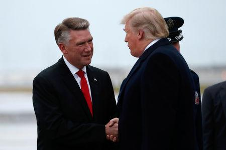 FILE PHOTO: U.S. President Donald Trump greets Harris, Republican candidate from North Carolina's 9th Congressional district in Charlotte