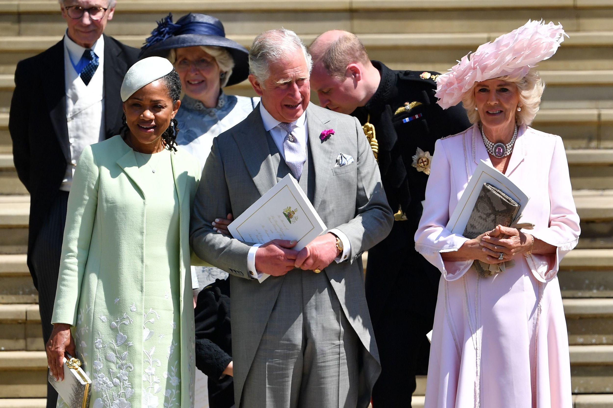 <p>Meghan Markle's mother Doria Ragland, Britain's Prince Charles, Prince of Wales and Britain's Camilla, Duchess of Cornwall leave the wedding ceremony of Britain's Prince Harry, Duke of Sussex and Meghan Markle.</p>  <p>(Photo by Ben STANSALL / POOL / AFP)</p>