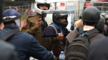Delhi policeman holds up mirror to motorbike law-breakers
