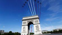 Macron to host downsized Bastille Day, outline crisis response