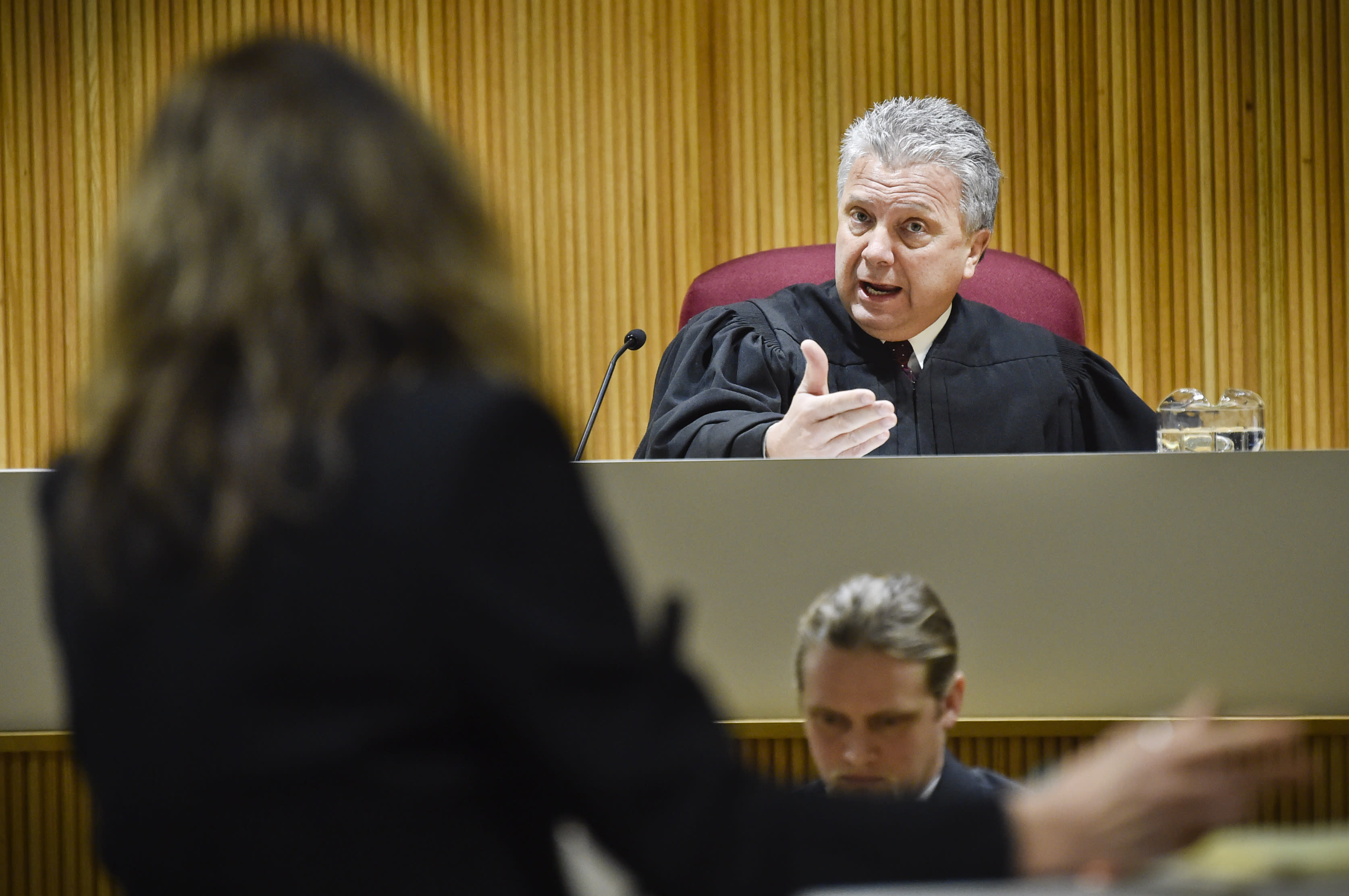 Montana Supreme Court Justice Dirk Sandefur, right, questions Maureen Lennon, attorney for the Montana Association of Counties, arguing on behalf of the Lincoln County Sheriff, on Wednesday, Jan. 8, 2020, in Helena, Mont., during arguments on whether local law enforcement officers have the authority to arrest people for alleged civil violations of federal immigration law. The ACLU, on behalf of Agustin Ramon, filed a lawsuit against Lincoln County in October 2018, after Ramon, a dual resident of Mexico and France, was arrested for stealing prescription medication from a neighbor's house in Eureka Court. (Thom Bridge/Independent Record via AP)