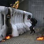 Violence Flares as Protesters Defy a Police Ban to March Through Hong Kong's Streets