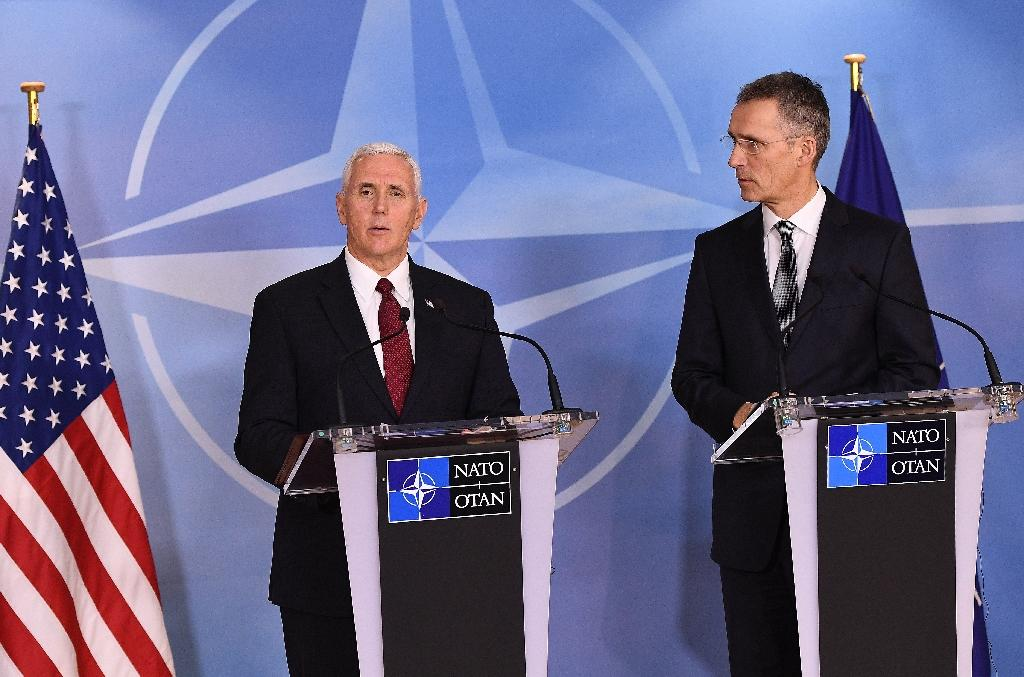 NATO Secretray General Jens Stoltenberg (R) and US Vice-President Mike Pence (L) give a press conference after a meeting at the NATO headquarters in Brussels on February 20, 2017 (AFP Photo/EMMANUEL DUNAND)