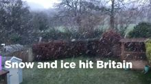 UK weather: snow falls across parts of Britain