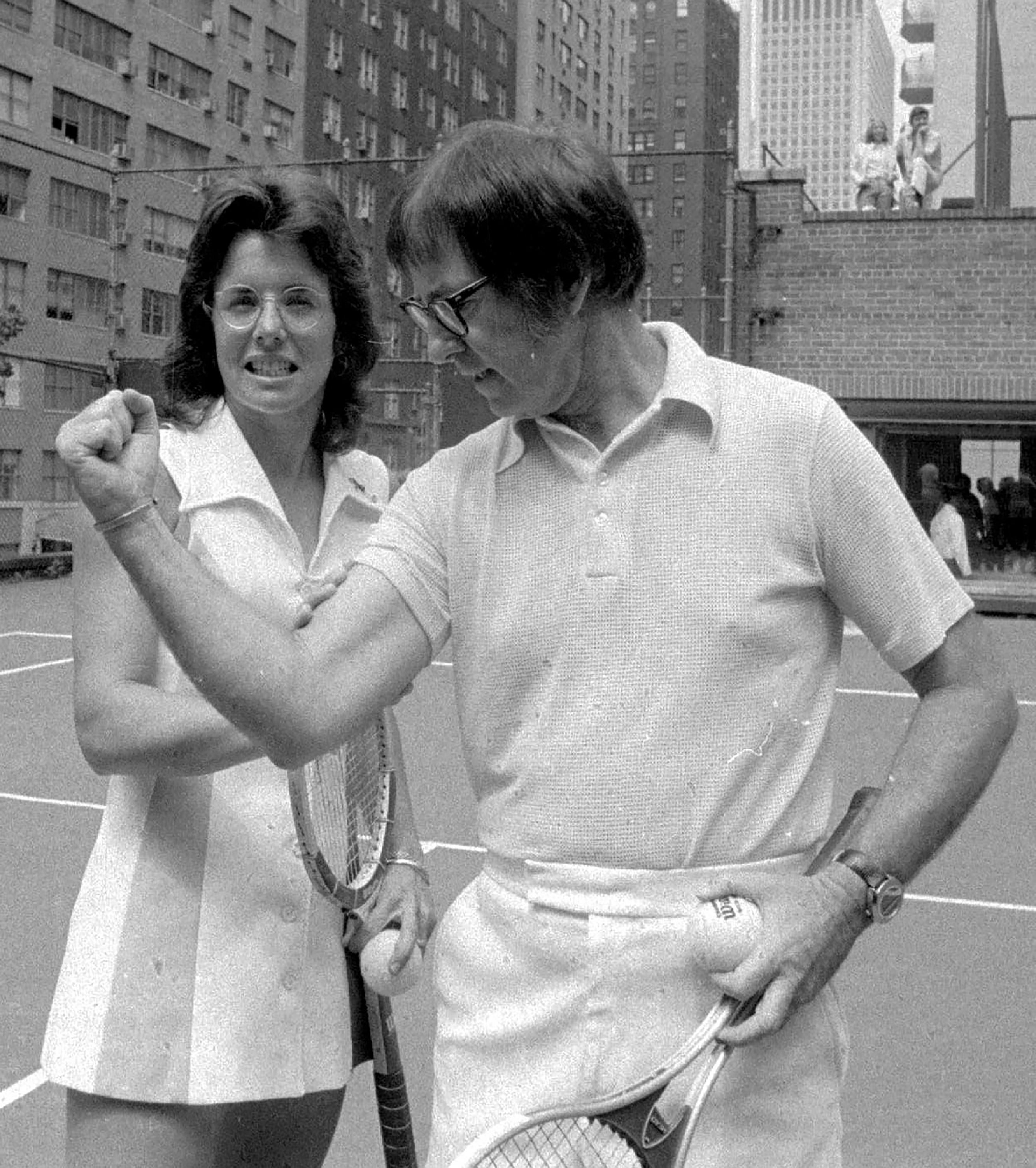 """FILE - Undated B/W file photo Bobby Riggs poses for Billie Jean King. King won 12 Grand Slam singles titles, including six at Wimbledon, but her most famous match came in 1973 when she beat 55-year-old Bobby Riggs 6-4, 6-3, 6-3 in the """"Battle of the Sexes."""" The Fed Cup is changing its name to honour tennis great Billie Jean King, becoming The Billie Jean King Cup, the first major global team competition to be named after a woman, it is announced Thursday Sept. 17, 2020. (AP Photo, FILE)"""