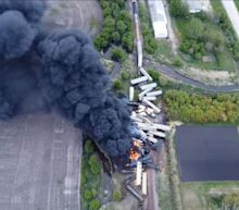 Train cars pile up, catch fire after derailment in northwest Iowa; evacuations ordered due to ammonium nitrate cargo