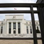 Fed pumps more cash as key rate breaks above target