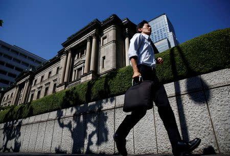 A man runs past the Bank of Japan (BOJ) building in Tokyo