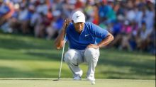 Cold putter curtails Tiger's PGA charge