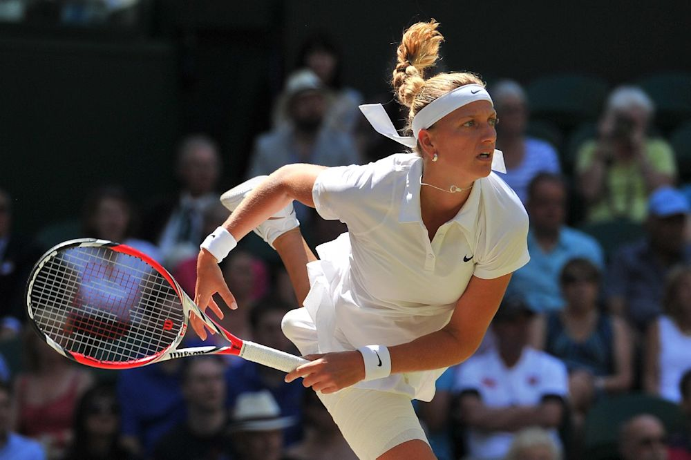 Petra Kvitova of the Czech Republic returns to compatriot Lucie Safarova during their Wimbledon singles semi-final on day ten of the 2014 Wimbledon Championships at The All England Club in Wimbledon, southwest London, on July 3, 2014